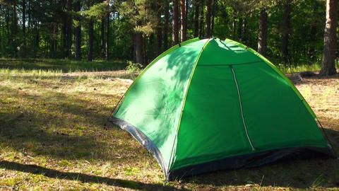 A green tent on the nature Footage