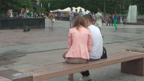 Loving couple on a bench by the fountain Stock Video Footage