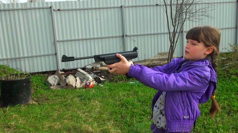 Girl shoots a gun Stock Video Footage