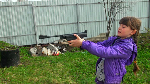 Girl shoots a gun Stock Video Footage