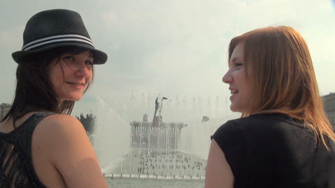 Girl friend at the fountain Stock Video Footage