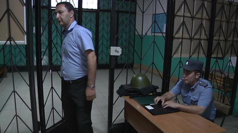 Police in the iron lattice Stock Video Footage