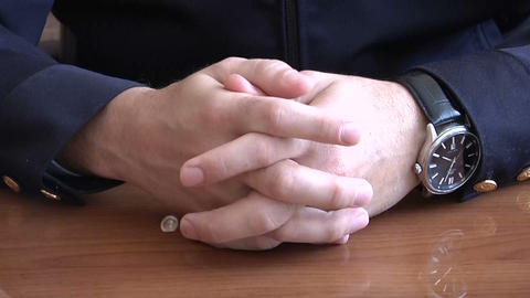 Men's hands clasped in castle Stock Video Footage