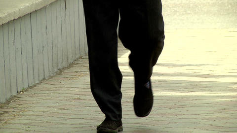 Mens feet in Slippers on the street Stock Video Footage