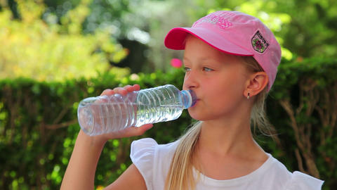 little girl drinking cold water, summer vacation Footage
