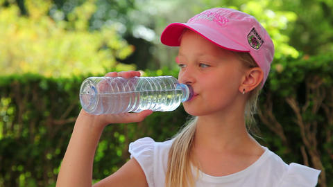 little girl drinking cold water, summer vacation Stock Video Footage