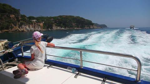 little girl on fast motor boat on sea waves, summe Stock Video Footage