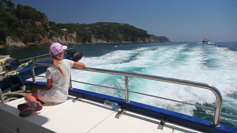 little girl on fast motor boat on sea waves, summe Footage