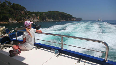 little girl on fast motor boat on sea waves, summe Stock Video Footage