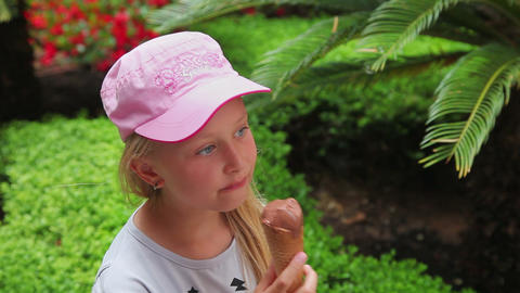 little girl eating delicious chocolate ice cream,  Footage