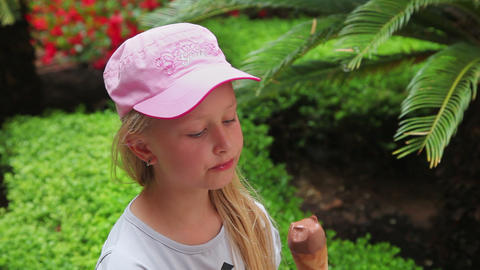 little girl eating delicious chocolate ice cream, Stock Video Footage