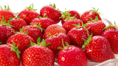 strawberries on white background - dolly shot Stock Video Footage