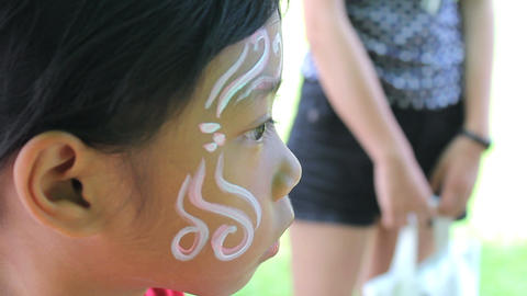 Face Painting Details On Little Girl Stock Video Footage