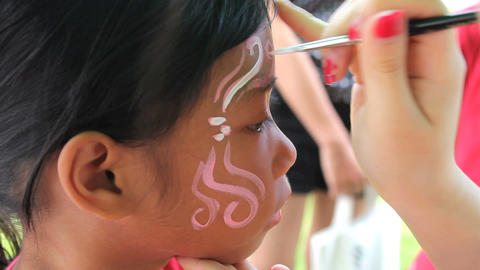 Girl Gets Face Painting At Carnival Stock Video Footage