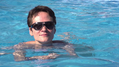 Swimming in the pool water HD Stock Video Footage