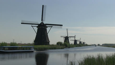 Dutch windmills and tourist boat Stock Video Footage