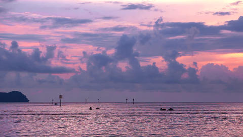 Silhouettes of people and boats at sunset Stock Video Footage
