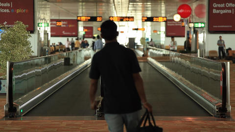 Passengers use the escalator in the airport buildi Stock Video Footage
