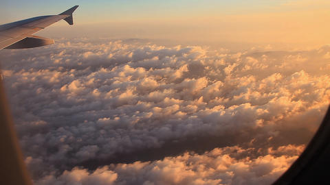 Clouds and sky as seen through window of an aircra Stock Video Footage