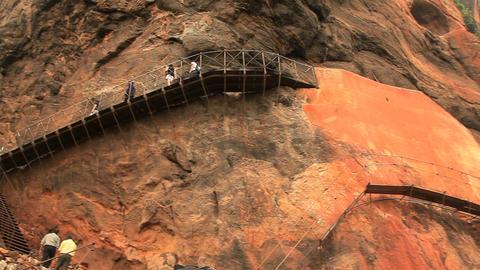 Scaffolds for walking fixed on steep rocks in Sigi Stock Video Footage