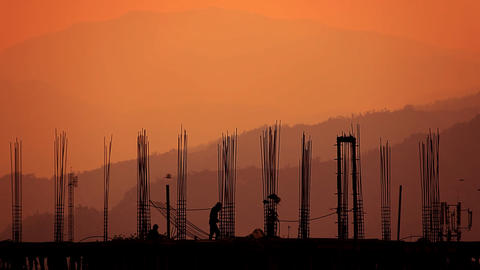 Silhouette of the worker and the building Stock Video Footage