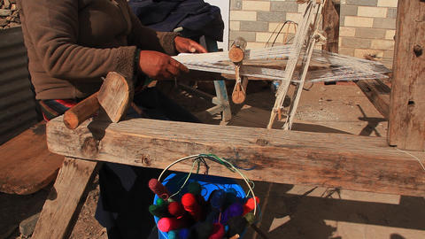 Woman weaving a traditional scarf Stock Video Footage