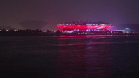 Watercraft traffic at night outside the Stadium Stock Video Footage