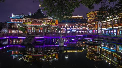 Crowds traffic at night in Yuyuen Garden Stock Video Footage