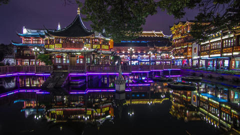 Crowds traffic at night in Yuyuen Garden Stock Video Footage