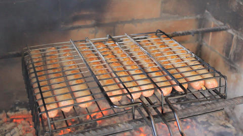 Roasting sausages on hot coals Stock Video Footage