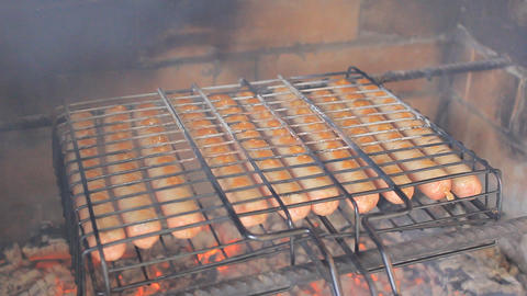 Roasting sausages on hot coals Footage