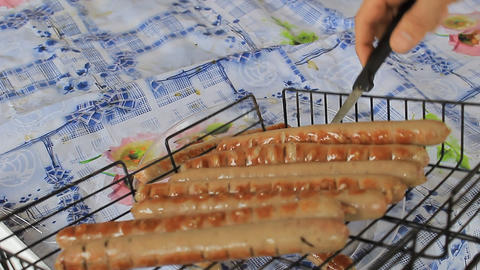 Sausages cooked on the coals Stock Video Footage