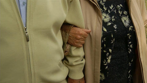 Grandmother holds the hand of the grandfather Stock Video Footage