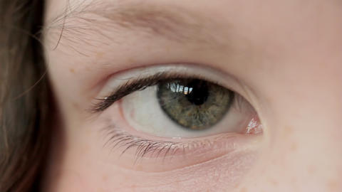Close up of girl's eye, rack focus Live Action