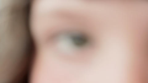 Close up of girl's eye, rack focus Stock Video Footage