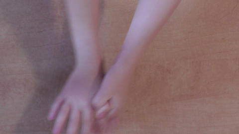 A pair of children's hands playing a game Stock Video Footage