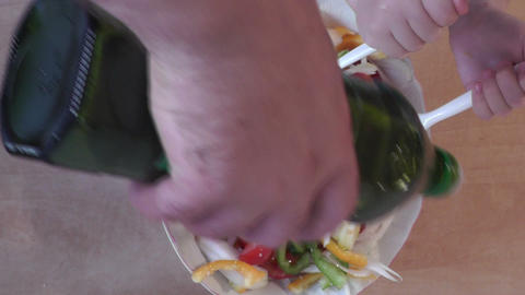 Pair of child hands mixing a colorful salad on the Stock Video Footage