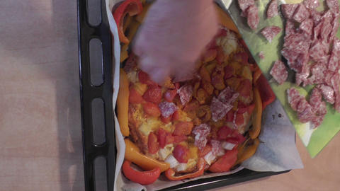 Close up shot of a black baking sheet and a person Stock Video Footage