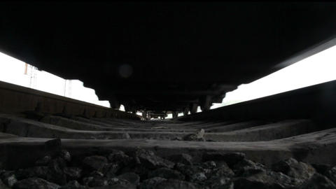 Train and wagons. View from below Stock Video Footage