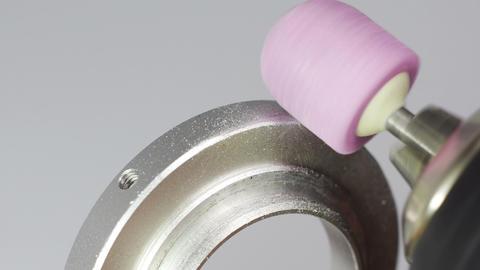 Grinding metal part with pink grinder tip Footage
