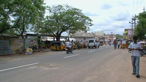 Tuk Tuks down the street in Madurai, India Stock Video Footage