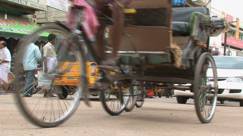 Low Angle Pan Following A Tuk Tuk stock footage