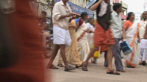 Busy street with a tuk tuk and a busy crowd Footage