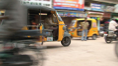 tuk tuks passing by Stock Video Footage