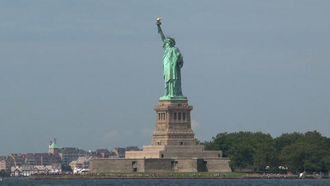Ferry behind The Statue of Liberty Footage