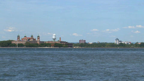 Water taxi passing by ellis island Stock Video Footage
