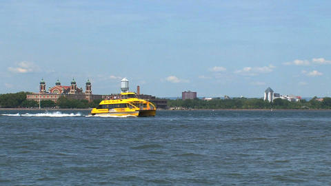 Water taxi passing by ellis island Footage