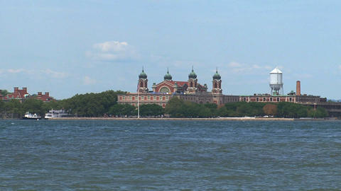 Ferry passing by ellis island Stock Video Footage