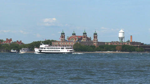 Ferry passing by ellis island Footage