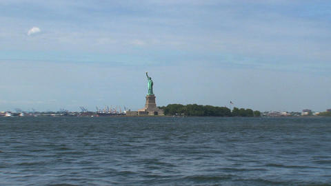 Zoom out from the water to The Statue of Liberty Footage